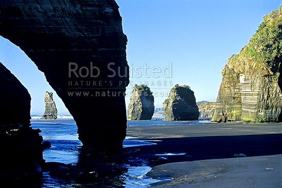 Looking north from Tongaporutu, past the '3 Sisters rocks', North Taranaki, New Plymouth District, Taranaki Region, New Zealand (NZ) stock photo.
