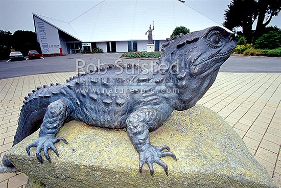 Bronze statue of Tuatara (Sphenodon punctatus) outside the Southland Museum and Art Gallery housed in a Pyramid shaped building, Invercargill, Invercargill District, Southland Region, New Zealand (NZ) stock photo.