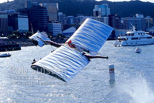 Wacky competitors in the Flugtag (Flying man) festival - unpowered flight, Wellington Wharf, Wellington, Wellington City District, Wellington Region, New Zealand (NZ) stock photo.