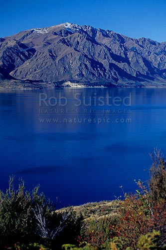 Corner Peak (1683m) above Lake Hawea, Hawea, Queenstown Lakes District, Otago Region, New Zealand (NZ) stock photo.