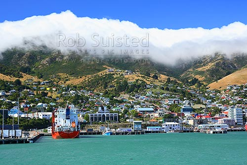 Port of Lyttelton with cloud rolling over the Port Hills from Canterbury, Lyttelton, Banks Peninsula District, Canterbury Region, New Zealand (NZ) stock photo.