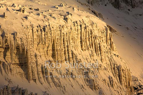 Snow covered ice ridges in setting sun, Franklin Island, Ross Sea, Ross Sea, Antarctica stock photo.