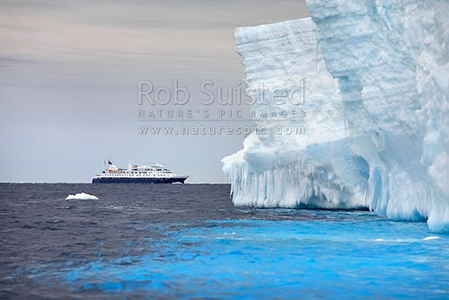 The expedition ship MV Orion in front of the Drygalski Ice Tongue and iceberg, Terra Nova Bay, Ross Sea, Antarctica District, Antarctica Region, Antarctica stock photo.