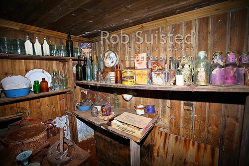 Artefacts and food supplies inside Borchgrevink's 1899 Southern Cross Expedition huts, Ridley Beach, Cape Adare, Ross Sea, Antarctica District, Antarctica Region, Antarctica stock photo.