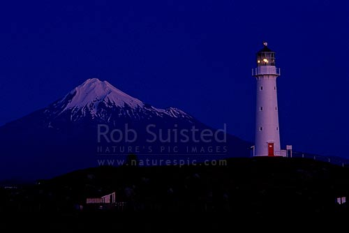 Cape Egmont Light house at Cape Egmont. Twilight. Mount Taranaki, Cape Egmont, Taranaki, South Taranaki District, Taranaki Region, New Zealand (NZ) stock photo.