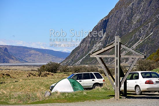 Department of Conservation (DOC) White Horse campground. Cars and tent camping. Self registering camping kiosk, Aoraki / Mount Cook National Park, MacKenzie District, Canterbury Region, New Zealand (NZ) stock photo.