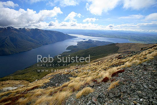 View from the Kepler Mountains over the South Fiord of Lake Te Anau with Murchison Mountains at left, Fiordland National Park, Southland District, Southland Region, New Zealand (NZ) stock photo.