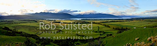 Panorama of Lake Te Anau, farmland and Fiordland National Park from above Te Anau township, Te Anau, Southland District, Southland Region, New Zealand (NZ) stock photo.