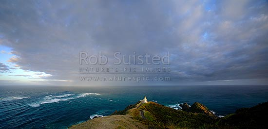 Panorama looking down on the Cape Reinga lighthouse (Te Rerengawairua) with first rays of dawn, Cape Reinga, Far North District, Northland Region, New Zealand (NZ) stock photo.