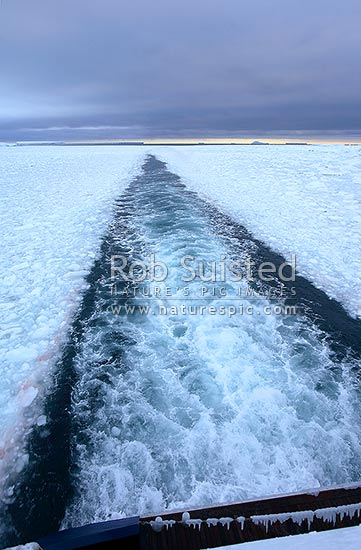 Ships track or wake through pack ice, Southern Ocean, Antarctica stock photo.