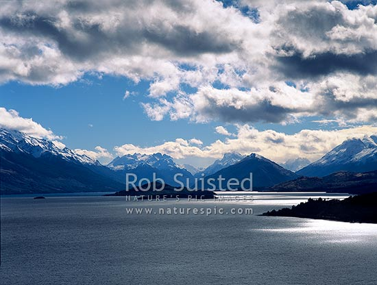 Looking up Lake Wakatipu to Glenorchy and the Greenstone, Rees and Dart Rivers. Pig and Pigeon Islands. Moody clouds forming, Queenstown, Queenstown Lakes District, Otago Region, New Zealand (NZ) stock photo.