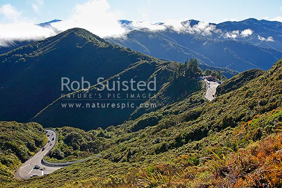 Remutaka (Rimutaka) Hill Road climbing to the 555m summit and linkng Wellington and the Wairarapa. Tararua Range beyond. (State Highway 2), Remutaka, Upper Hutt City District, Wellington Region, New Zealand (NZ) stock photo.