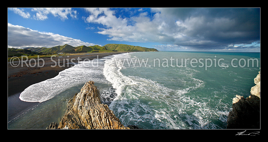 Image of Looking along White Rock Beach to Te Kaukau Point. Bent and buckled limestone skeleton reef 50-60 million years old in foreground, White Rock, Wairarapa, South Wairarapa District, Wellington Region, New Zealand (NZ) stock photo image