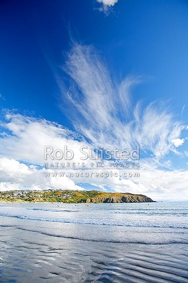High wispy cirrus clouds over Titahi Bay beach, Titahi Bay, Porirua City District, Wellington Region, New Zealand (NZ) stock photo.