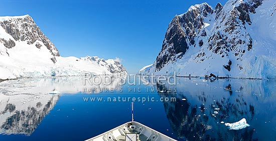 Lemaire Channel on a perfect day! Expedition cruises ship Prince Albert II. Panorama, Lemaire Channel, Antarctic Peninsula, Antarctica Region, Antarctica stock photo.