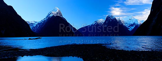 Mitre Peak above Milford Sound Fiordland. Mitre Peak left (1683m). The Lion (1302m) and Mt Pembroke (2015m) at right. Winter panorama at dawn, Milford Sound, Fiordland National Park, Southland District, Southland Region, New Zealand (NZ) stock photo.