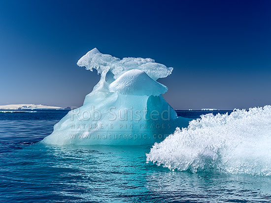 Blue Iceberg floating in Terra Nova Bay, Ross Sea, Antarctica Region, Antarctica stock photo.