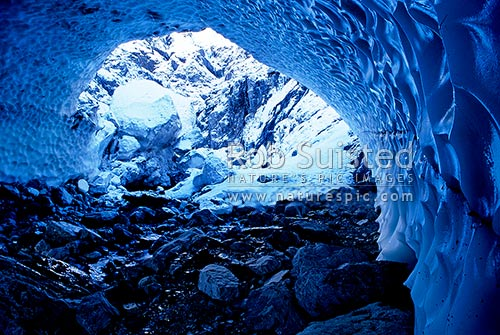 Natural snow arch in the head of the Bealey River, Arthur's Pass National Park, New Zealand (NZ) stock photo.