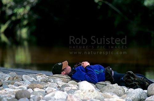 A hard day trout fishing!, Karamea, Buller District, West Coast Region, New Zealand (NZ) stock photo.