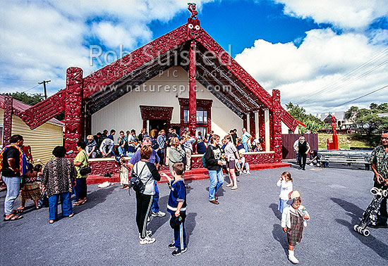 Visitors gather outside Te Pakira, Marae of Whakarewarewa thermal village, Rotorua, Rotorua, Rotorua District, Bay of Plenty Region, New Zealand (NZ) stock photo.